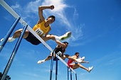 Track and Field, runners jumping over hurdles