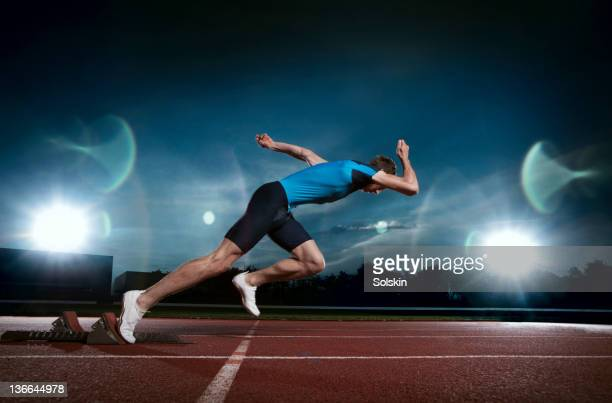 Track and field sprinter coming out of blocks