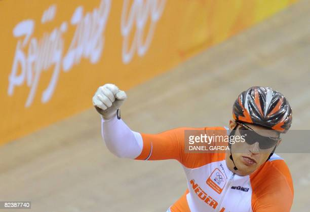 Track cyclist Theo Bos of the Netherlands celebrates after winning against Mark French of Australia in the 2008 Beijing Olympic Games men's sprint...