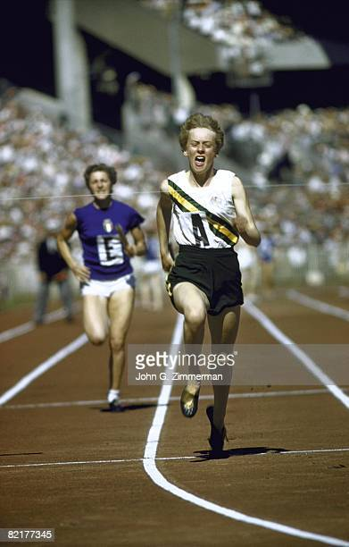 1956 Summer Olympics Australia Betty Cuthbert in action crossing finish line and winning 4x100M Relay at Melbourne Cricket Ground Stadium Melbourne...
