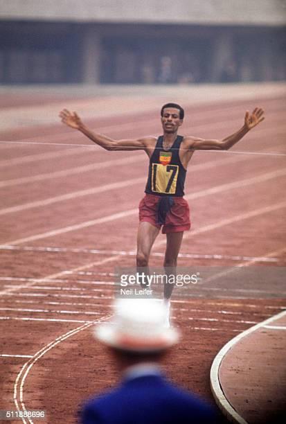 1964 Summer Olympics Ethiopia Abebe Bikila in action crossing finish line to win Marathon gold at National Olympic Stadium Tokyo Japan CREDIT Neil...