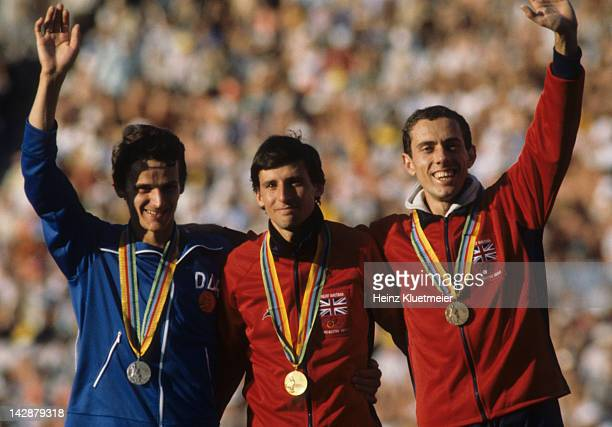 1980 Summer Olympics Closeup of West Germany Jurgen Straub Great Britain Sebastian Coe and Steve Ovett victorious with silver gold and bronze medals...