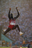 Track Field 1984 Summer Olympics USA Carl Lewis in action during Men's Long Jump at Los Angeles Memorial Coliseum Lewis won four gold medals 100M...