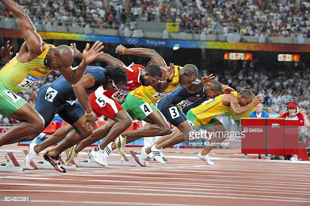 2008 Summer Olympics Jamaica Usain Bolt in action vs Trinidad Tobago Richard Thompson and USA Walter Dix during start of Men's 100M Final at National...