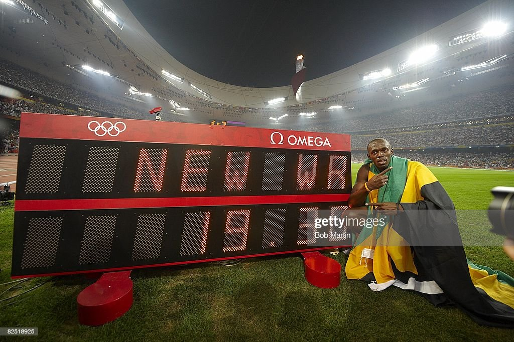 2008 Summer Olympics Jamaica Usain Bolt victorious with world record sign after winning Men's 200M Final gold medal with time of 1930 at National...