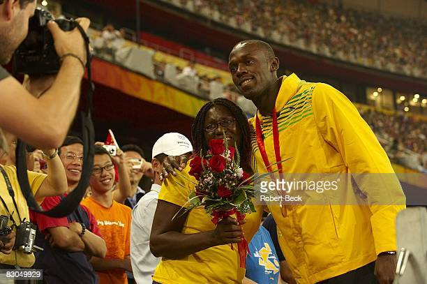 2008 Summer Olympics Jamaica Usain Bolt victorious with mother Jennifer after winning Men's 100M Final gold medal with world record time of 969 at...