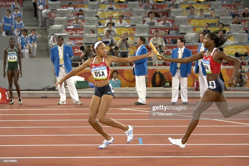 USA Mary Wineberg in action, passing baton to teammate Allyson Felix (Lane 4) during Women's 4x400M Relay Final at National Stadium ( Bird's Nest ). Beijing, China 8/23/2008