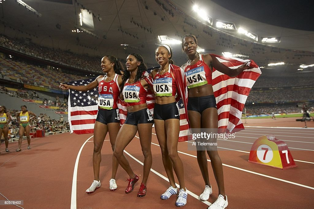 USA Sanya Richards, Monique Henderson, Mary Wineberg and Allyson Felix victorious after Women's 4x400M Relay Final at National Stadium ( Bird's Nest ). USA won gold. Beijing, China 8/23/2008