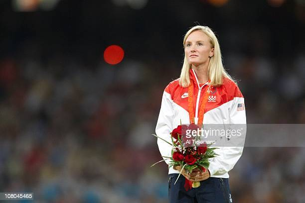 2008 Summer Olympics USA Shalane Flanagan victorious on medal stand after winning Women's 10000M Final bronze at National Stadium Beijing China...