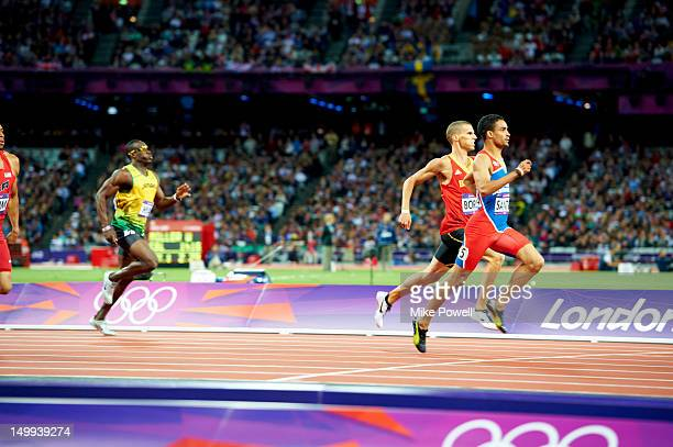 2012 Summer Olympics Belgium Kevin Borlee and Dominican Republic Luguelin Santos in action during Men's 100M Semifinals at Olympic Stadium London...