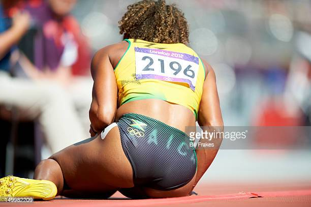 2012 Summer Olympics Closeup of Jamaica Brigitte FosterHylton on ground after sustaining injury during Women's 100M Hurdles Heats at Olympic Stadium...