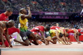 2012 Summer Olympics Jamaica Usain Bolt on starting block before start of Men's 100M Final at Olympic Stadium Bolt wins gold and sets new Olympic...
