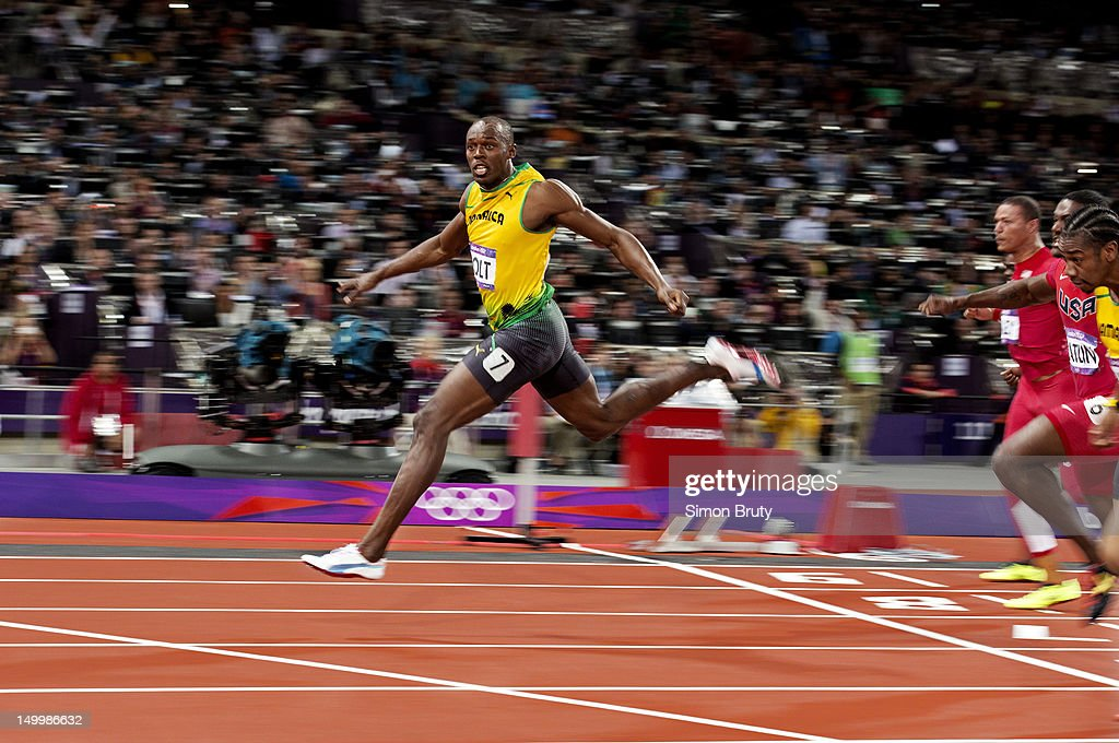 Jamaica Usain Bolt victorious, crossing finish line after winning Men's 100M Final gold at Olympic Stadium. Bolt set Olympic record with time of 9.63. Cover. Simon Bruty X155196 TK3 R1 F23 )