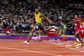 2012 Summer Olympics Jamaica Usain Bolt victorious crossing finish line after winning Men's 100M Final gold at Olympic Stadium Bolt set Olympic...