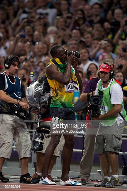 2012 Summer Olympics Jamaica Usain Bolt with camera after Men's 200M Final at Olympic Stadium Bolt wins gold London United Kingdom 8/9/2012 CREDIT...