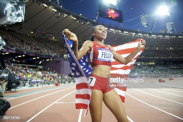 2012 Summer Olympics USA Allyson Felix victorious with American flag after Women's 200M Final at Olympic Stadium Felix wins gold London United...