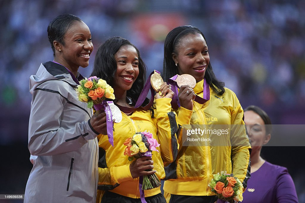 USA Carmelita Jeter (silver), Jamaica Shelly-Ann Fraser-Pryce (gold), Jamaica Veronica Campbell-Brown (bronze) victorious with medals after Women's 100M Final at Olympic Stadium. Robert Beck X155160 TK9 R1 F259 )
