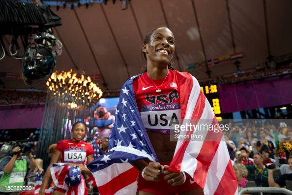 2012 Summer Olympics USA DeeDee Trotter victorious after winning gold during Women's 4x400M Relay Final at Olympic Stadium London United Kingdom...