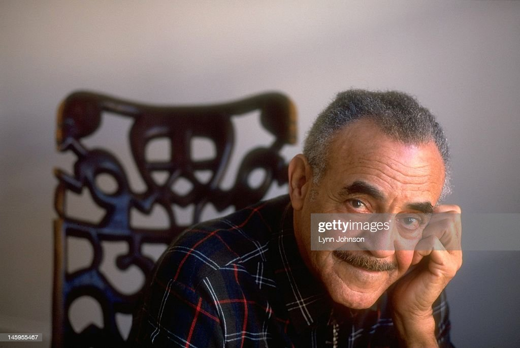 Closeup portrait of former Olympic runner Mal Whitfield during photo shoot. Whitfield won three Olympic gold medals as a runner, flew in World War II as a member of the Tuskegee Airmen, and later served in the US Department of State developing sports clinics in Africa. Lynn Johnson X49685 )