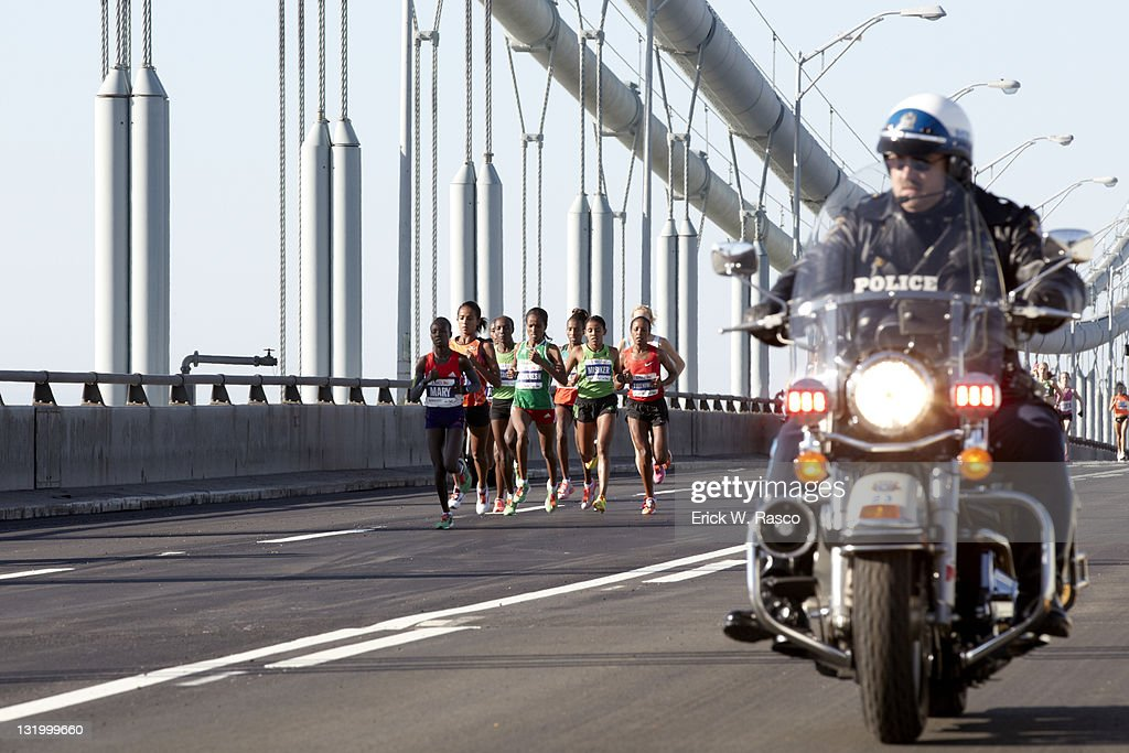 Ethiopia Firehiwot Dado and others in action crossing Verrazano Narrows Bridge. Dado wins women's marathon with a time of 2 hours, 23 minutes, 15 seconds. Erick W. Rasco F63 )