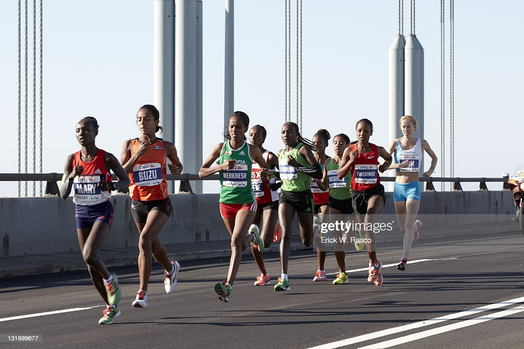 Ethiopia Firehiwot Dado and others in action crossing Verrazano Narrows Bridge. Dado wins women's marathon with a time of 2 hours, 23 minutes, 15 seconds. Erick W. Rasco F67 )