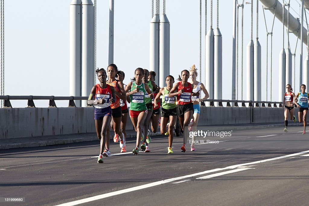 Ethiopia Firehiwot Dado and others in action crossing Verrazano Narrows Bridge. Dado wins women's marathon with a time of 2 hours, 23 minutes, 15 seconds. Erick W. Rasco F64 )