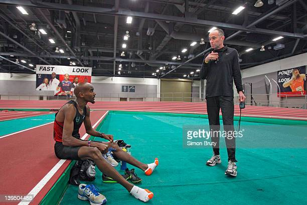 Mo Farah with his long distance running coach Alberto Salazar during training session at Indoor Track at the Albuquerque Convention Center...