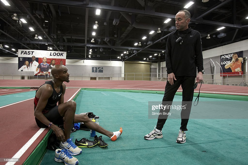 <a gi-track='captionPersonalityLinkClicked' href=/galleries/search?phrase=Mo+Farah&family=editorial&specificpeople=4819130 ng-click='$event.stopPropagation()'>Mo Farah</a> with his long distance running coach <a gi-track='captionPersonalityLinkClicked' href=/galleries/search?phrase=Alberto+Salazar&family=editorial&specificpeople=3459884 ng-click='$event.stopPropagation()'>Alberto Salazar</a> during training session at Indoor Track at the Albuquerque Convention Center. Albuquerque, NM 2/14/2012