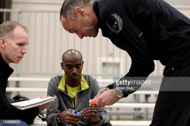 Mo Farah with his long distance running coach Alberto Salazar and during training session at Indoor Track at the Albuquerque Convention Center...