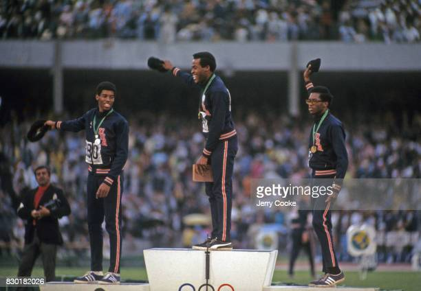 Summer Olympics USA Larry James Lee Evans and Ron Freeman on medal stand after Men's 400M race at Estadio Olimpico Evans wins gold James wins silver...