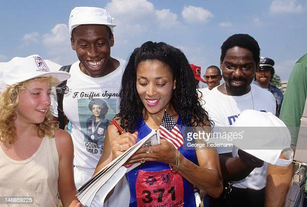 US Olympic Trials Florence GriffithJoyner signing autographs for fans after Women's 100M race at IU Michael A Carroll Track Soccer Stadium Joyner's...
