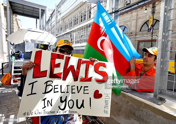 A track marshal with a Lewis Hamilton of Great Britain and Mercedes GP sign and an Azerbaijan flag before the European Formula One Grand Prix at Baku...