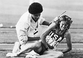 A track official attempts to comfort a crying Mary Decker after Decker's fall in the women's 3000meter run at the 1984 Summer Olympics Decker fell...