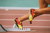 Track sprinter taking off from starting block, low section