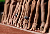 Track sprinters lined up at starting line