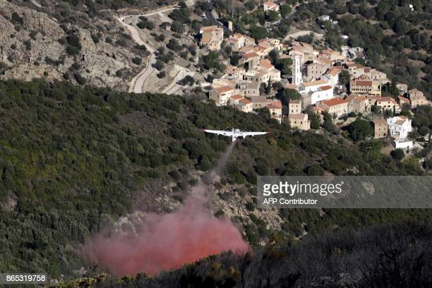 Tracker firefighting plane drops flame retardant over a wildfire near Palasca on October 23 after a fire that devastated nearly 2000 hectares of...