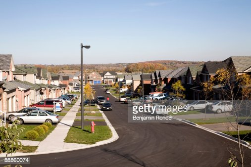 Tract housing road and driveways : Stock Photo