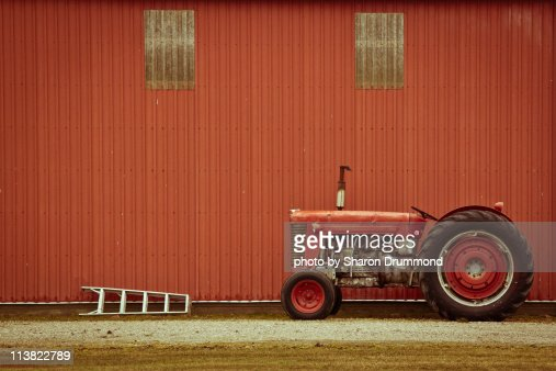 Tractor and Ladder beside Barn