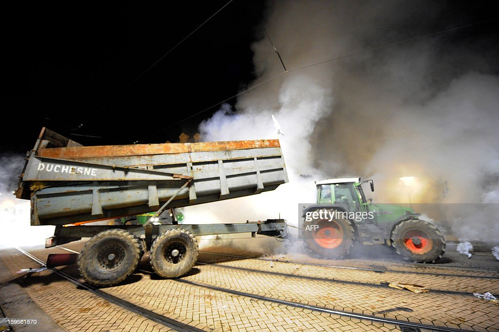 A tractor arrives near the Sarthe prefecture late on January 15, 2013 in Le Mans, western France during a protest called by farmers union FNSEA against new constraints arising from the applications of European Union rules against nitrates. A new map identifies 'vulnerable areas' to nitrates which require special protection to not pollute water resources. AFP PHOTO / JEAN FRANCOIS MONIER