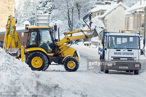 A tractor clears snow off roads in Hawick in Scotland on January 7 2010 Eurostar passengers faced new winter misery when another highspeed train...