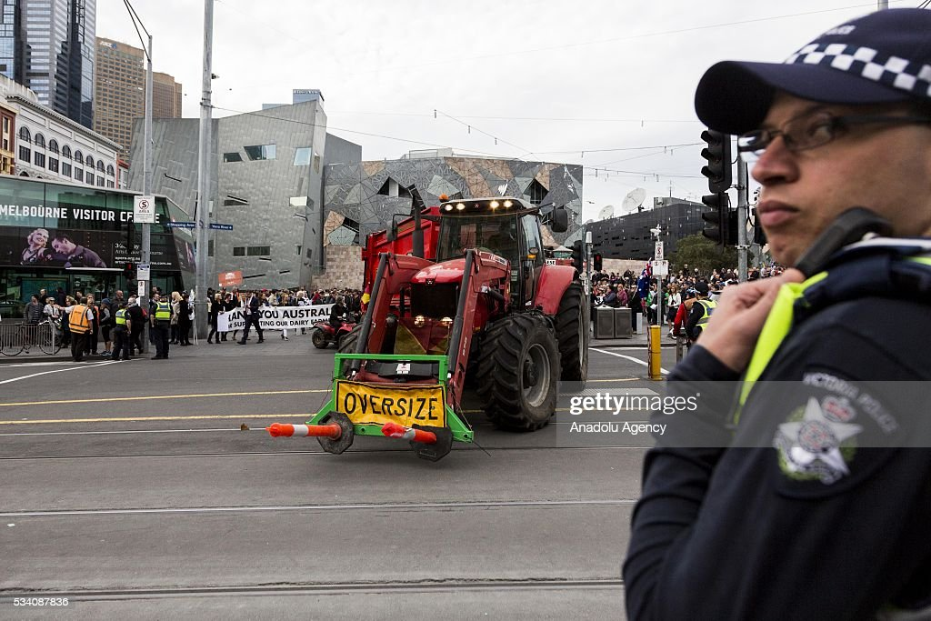 A tractor crosses a major intersection in Melbourne CBD outside Federation Square during a protest demanding Australian government to solve the dairy crisis in Melbourne, Australia on May 25, 2016.