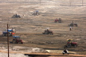 Tractor drivers level the ground during preparations ahead of the Maha Kumbh festival at Sangam in Allahabad on November 15 2012 Allahabad located in...