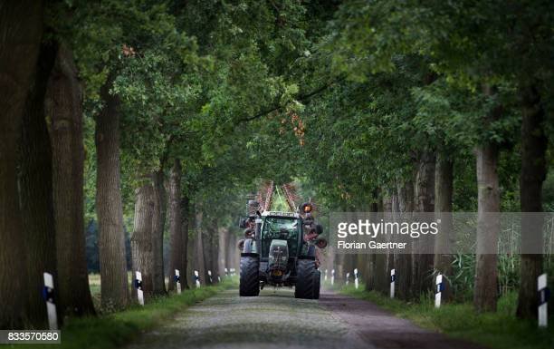 A tractor drives along a narrow cobblestone road on August 15 2017 in Werben Germany
