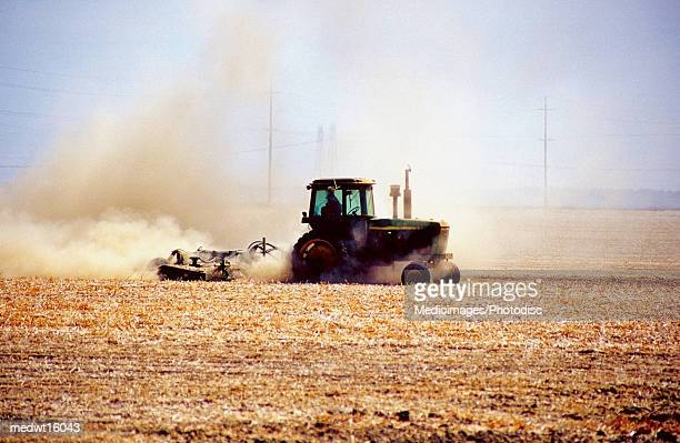 A tractor in motion on a farm in the USA