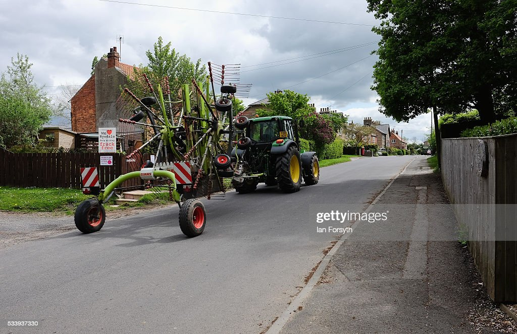 A tractor is driven through the village of Kirby Misperton in North Yorkshire near the site of the KM8 fracking site on May 24, 2016 in Malton, England. North Yorkshire's Planning and Regulatory Committee voted seven to four in favour of a planning application submitted by Third Energy to carry out fracking at the KM8 site. Hydraulic fracturing, or fracking, is a technique designed to recover gas and oil from shale rock.