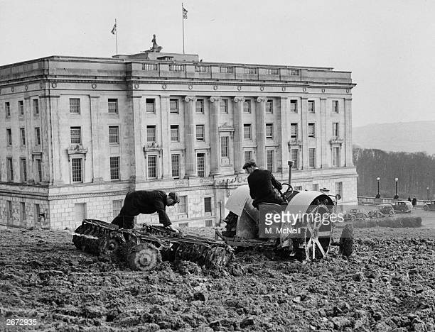 A tractor ploughing land beside Parliament Building on the Stormont Estate The Northern Ireland Government is having the land ploughed as part of the...