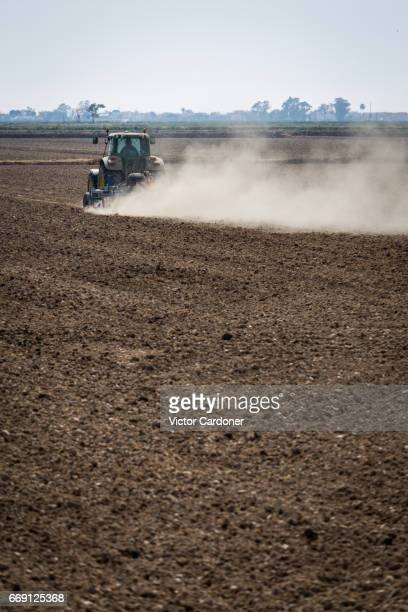 Tractor plowing farm land