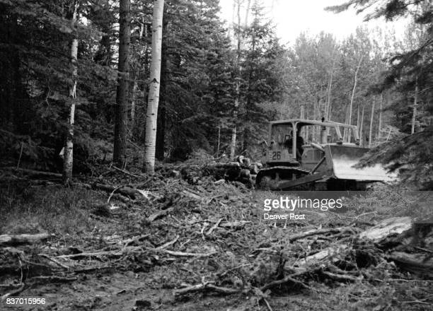 Tractor Skids logs out of San Juan National Forest Area where Trees are selectively logged A new timbermanagement system mostly involves partial...