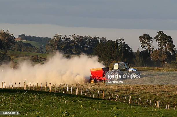 A tractor spreads fertiliser at a dairy farm on April 18 2012 in Morrinsville New Zealand Raw milk sales are growing as more people are educating...