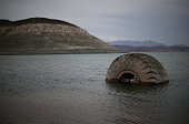 A tractor tire sits in the waters of Lake Mead near Boulder Beach on May 13 2015 in Lake Mead National Recreation Area Nevada As severe drought grips...